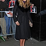 Jennifer Lopez's purple satin Giuseppe Zanotti ankle-strap sandals and leopard Valentino bag made her fur-collar Diane von Furstenberg coat pop majorly. To mimic this look in your city, wear your plush outerwear as a dress, then finish off with bright-colored footwear and a printed clutch. Cat-eye sunglasses are optional but will lend a retro touch.