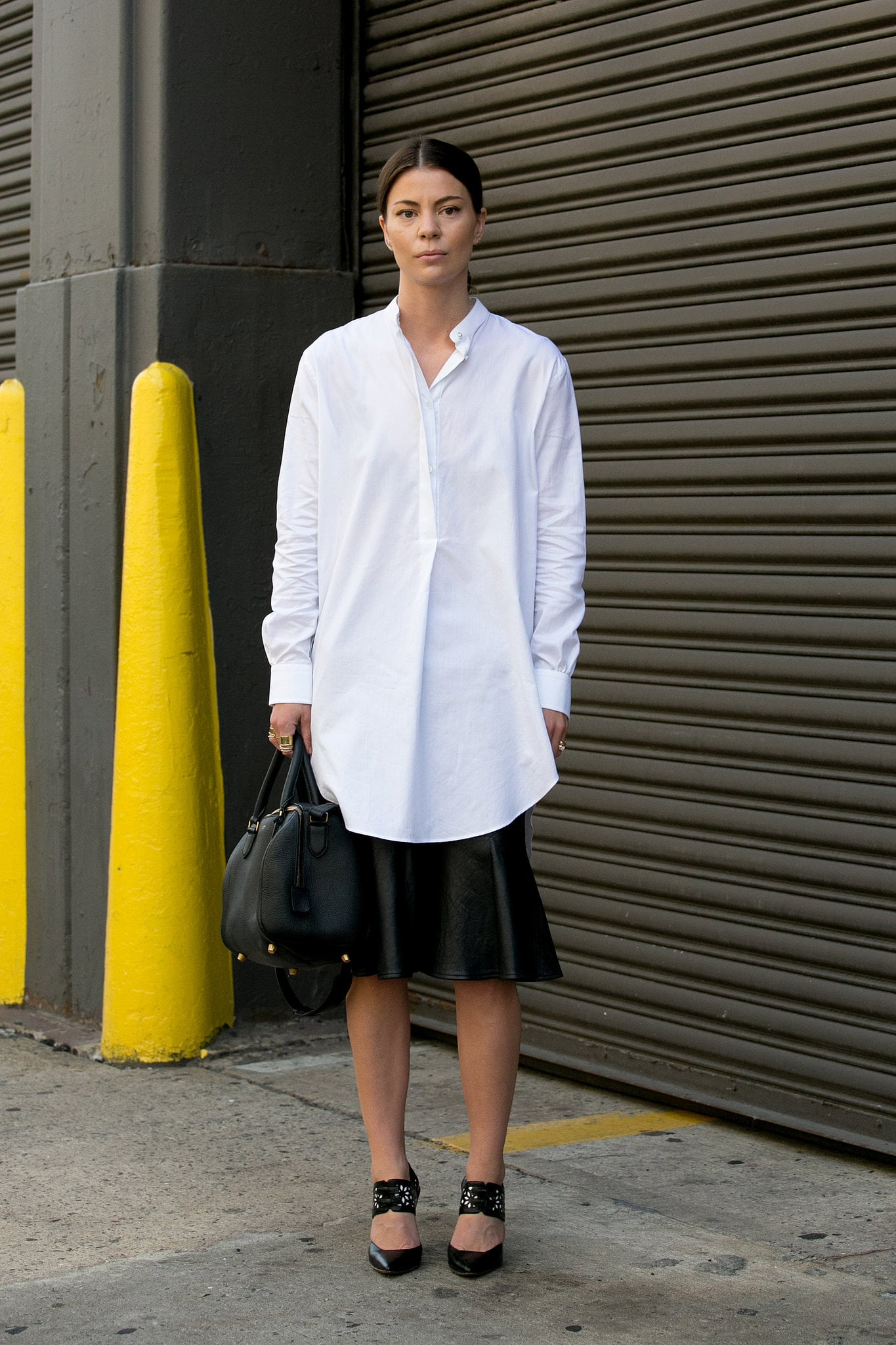 A basic white button-down is our go-to year-round; just make it feel easy with a midiskirt and heels for an effortless office ensemble.