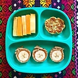 """""""Lunch: banana, peanut butter and 22-grain bread 'sushi' rolls, broccoli and cauliflower cheezy bites, apples, and cheddar cheese."""""""