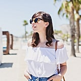 Whilst catching some rays in Barcelona, I teamed a simple floaty, folky crop-top with the button-up denim skirt of the season (two trends in one!) and strappy sandals. Denim and white is always a classic combination, but the Bardot neckline really gave this look the holiday vibe that I was aiming for (plus, no pesky strap marks!)