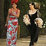Dita Von Teese arrived with a friend to Aaron Paul and Lauren Parsekian's Malibu wedding in May 2013.