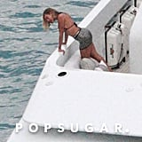 Beyoncé prepared to jump from on top of her big boat.
