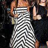 Anna Dello Russo made her way into Oscar de la Renta's show in a dramatic striped design.