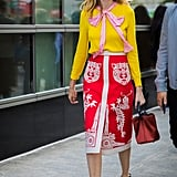 Tuck a Mustard Yellow Blouse Into a Printed Skirt