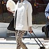 Chances are Cameron Diaz's leopard-print pants and sleek white coat are a lot cooler than your usual airplane look, but they're just as easy to throw together and just as comfy when you finish off the look with flats and a sharp tote like her Saint Laurent.