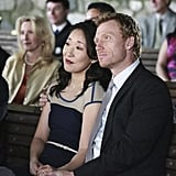 Then-couple Cristina and Owen Hunt (Kevin McKidd) watch Callie and Arizona exchange vows.