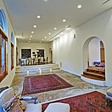 The long stretches of hallway contribute to how large the home feels.  Source: Everett Fenton Gidley