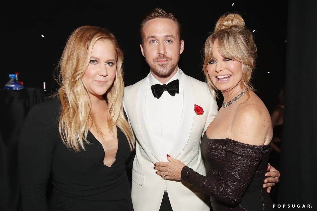 Amy Schumer and Goldie Hawn held on to Ryan Gosling after his win (as anyone would).
