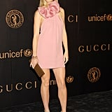 Donning a blush-pink, bow-accented Gucci mini and strappy patent leather sandals, Gwyneth was the epitome of ladylike elegance in NYC.
