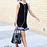 Natalie Joos might as well have been on the catwalk as she strutted down the sidewalk in a fringe-trimmed dress, red heels, and headphones.