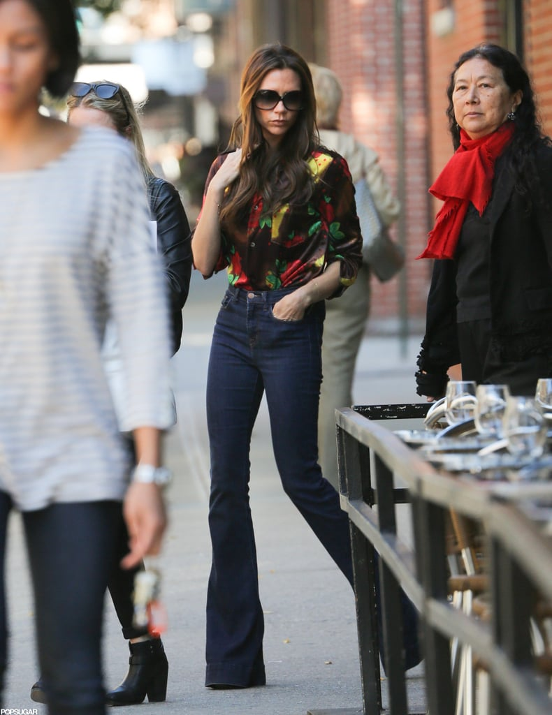 Victoria Beckham joined a group of friends for an NYC outing this afternoon. She was dressed down in flared denim and a floral top, though she was missing the cute photo bracelet featuring herself and Harper that she tweeted a picture of earlier today. Victoria and Harper arrived on the East Coast on Friday night following a girls-only trip to London. While she was in the UK, Victoria released images of her Elle France photo shoot with Karl Lagerfeld. She also shared a snap of the November issue's cover, which features Victoria wearing a blue collared dress from her own collection. Naomi Watts stepped out in a neutral version of the same frock last week.