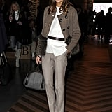 Olivia Palermo kept it classy with sleek tailored trousers — we love the the subtle plaid print as a great addition to a more formal daytime look.