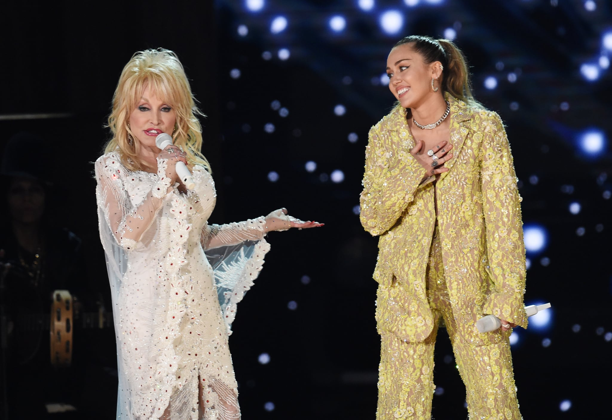 LOS ANGELES, CA - FEBRUARY 10:  Dolly Parton (L) and Miley Cyrus perform onstage during the 61st Annual GRAMMY Awards at Staples Centre on February 10, 2019 in Los Angeles, California.  (Photo by Kevin Winter/Getty Images for The Recording Academy)
