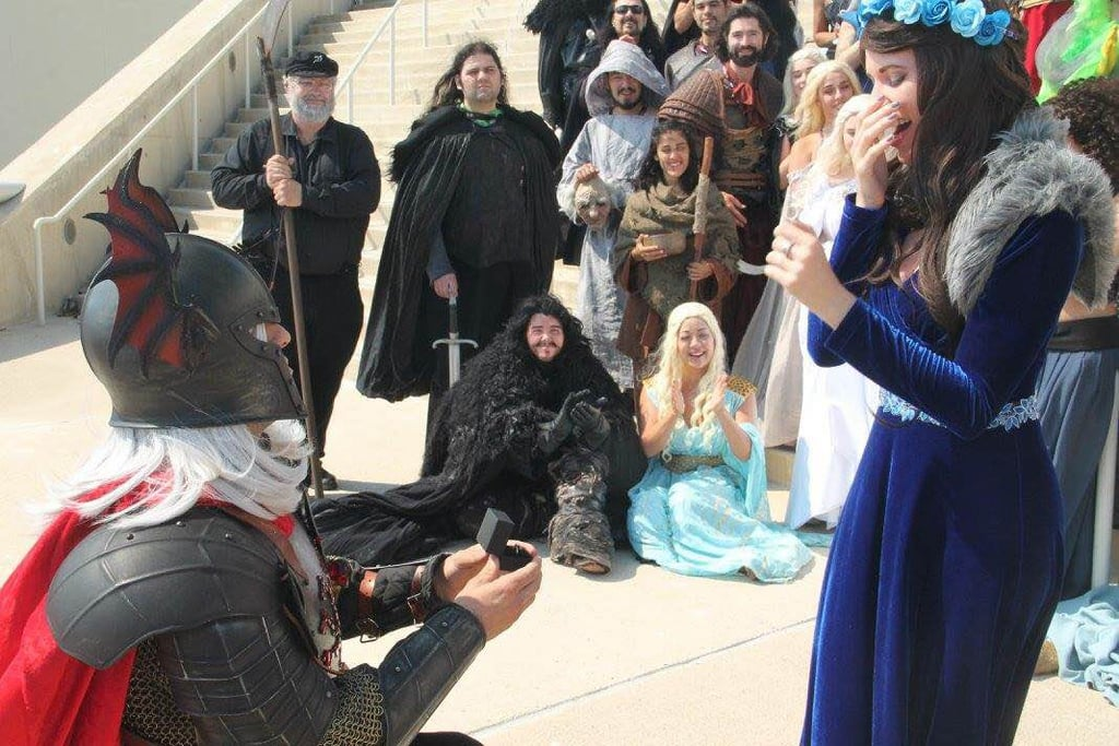 "The sweetest marriage proposals can happen anywhere — even if you're in full cosplay and in the middle of Comic-Con. That's the story behind one epic Game of Thrones proposal that happened at this year's Comic-Con.  Hayley Smith and Christopher Setts regularly do couples cosplay, with Smith most of the time dressing as Daenerys Targaryen. However, for Comic-Con, Setts told Smith he wanted to be Rhaegar Targaryen. She went along with it and dressed as Lyanna Stark for the event. The actual story details about the two in the show are still a bit murky, but nothing is mysterious when it came to Setts proposing to Smith. She said yes! The couple is now happily looking forward to planning a Game of Thrones-themed wedding. Their plan revolves around ""showcasing the different houses and an overall castle and/or medieval theme tied into the Game of Thrones world,"" said Smith in a Facebook message. They plan on keeping it full of light and no terrors. ""Of course no red wedding theme!"" said Smith. Of course, the couple is heavily invested in the show and who will win the Iron Throne. ""After reading the books and watching the latest season on HBO, I am confident that Daenerys Targaryen will end up taking the Iron Throne, making an alliance with Jon Snow in the process,"" said Smith. She's not the only one who thinks so. Ahead, take a look at the photos from their amazing proposal. It's something out of a Westerosi dream.      Related:                                                                7 Heartwarming Geeky Proposals That Will Make Your Day                                                                   Get Ready For the Most Over-the-Top Geek Wedding Your Eyes Have Seen                                                                   This Couple Had the Star Wars Wedding of Your Galactic Dreams                                                                   This Might Be the Ultimate Geek Proposal — Prepare to Say ""Awww"""