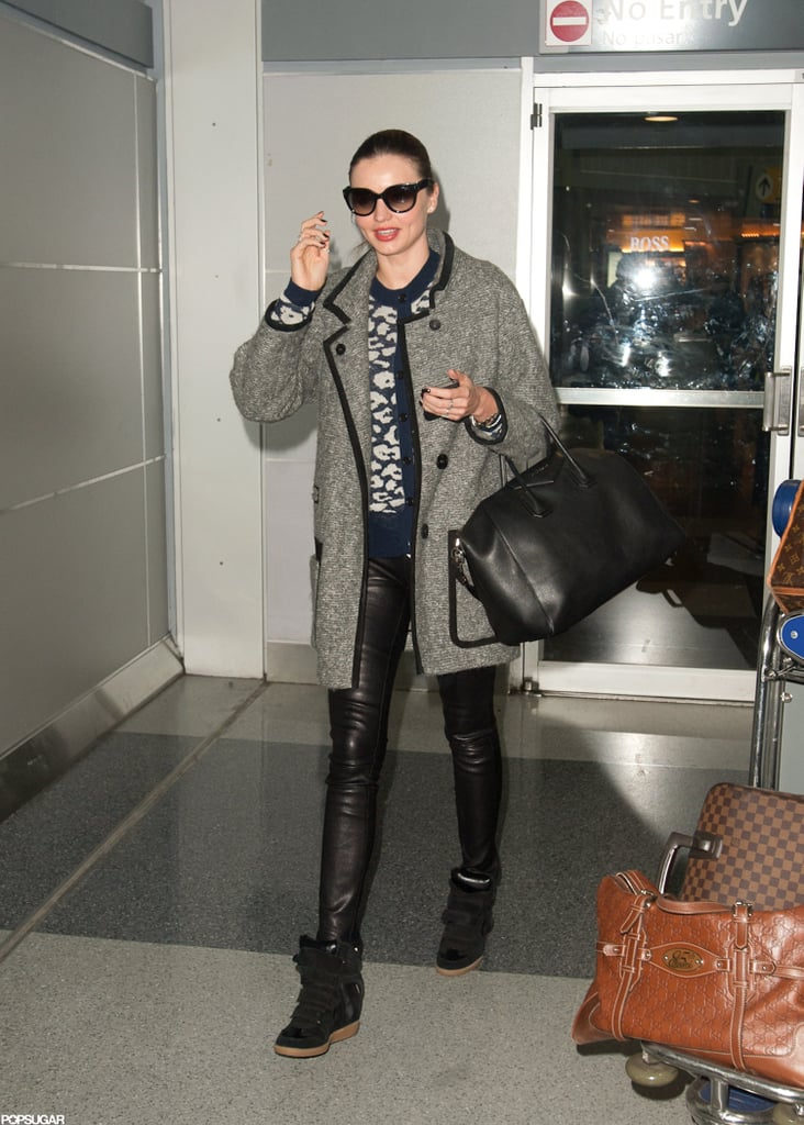 Miranda Kerr touched down in NYC on a flight from LA.