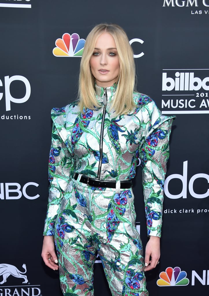 Sophie Turner took the night off from defending the North to show face at the 2019 Billboard Music Awards, and she absolutely looked like a queen. On Wednesday, the Game of Thrones star posed for red carpet photos in a metallic jumpsuit ahead of the award show in Las Vegas. Standing alongside her X-Men: Dark Phoenix costar Tye Sheridan, the duo smiled adorably while Sansa Sophie also worked her smize in solo shots.  It's a big night for Sophie — not only is fiancé Joe Jonas performing with the Jonas Brothers at their first award show in over a decade, but Sophie is presenting an award with Tye. While the rest of the world is still reeling from the jaw-dropping Battle of Winterfell, Sophie is slaying the night (even without the dragonglass dagger Arya gave her). Check out the stunning photos ahead.      Related:                                                                                                           The Jonas Brothers Turned the Billboard Music Awards Into a Triple Date Night