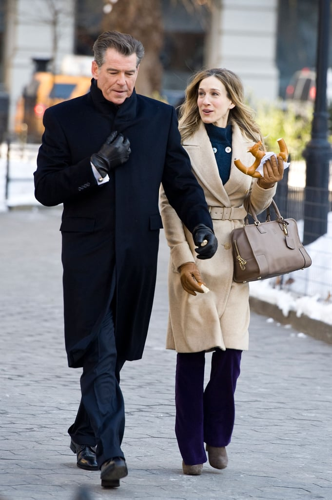 Sarah Jessica Parker has been busy filming I Don't Know How She Does It in New York recently, with Olivia Munn and Kelsey Grammer. Yesterday she was joined by yet another costar, Pierce Brosnan, in Central Park. SJP looked cold in the freezing weather and kept her hands warm inside a black coat between takes, before grabbing her pretzel to laugh her way through another take with Pierce.