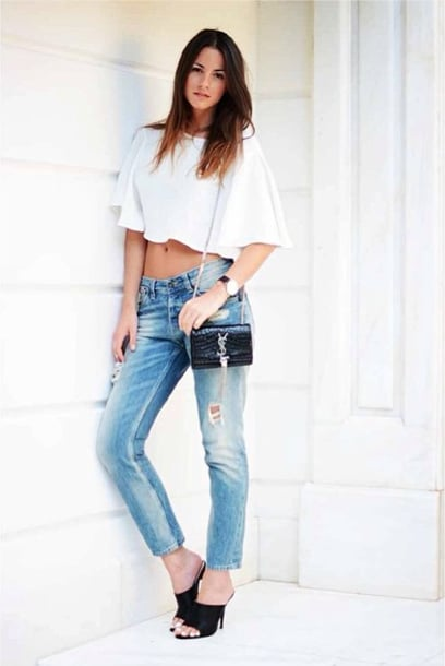 Give old jeans new life with a crop top and a pair of high-heeled mules for date night.  Source: Instagram user zinafashionvibe