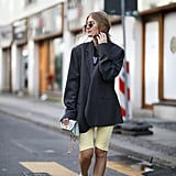 Running errands but don't want to wear sweats? Dress up you casual look of a t-shirt and biker shorts with a chic blazer.
