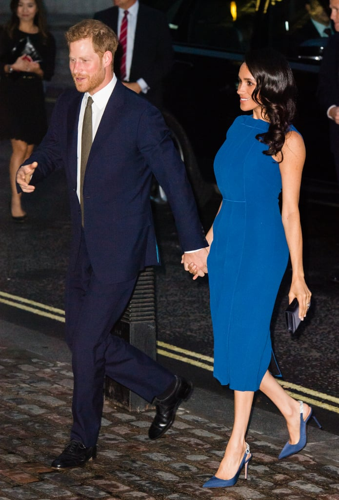 There really is no rest when you're a royal. Fresh from her flawless appearances at a special performance of Hamilton and the WellChild awards, Meghan Markle once again stepped out on the arm of her husband, Prince Harry, for a charitable event. This time around, the royal couple attended the 100 Days to Peace concert, which raised funds for a number of charities, including Heads Together — a charity founded by Prince Harry and the Duke and Duchess of Cambridge. Having stuck to all-black looks for her most recent outings — a look that is quickly becoming the new Duchess of Sussex's trademark — this time, Meghan opted for a bright blue Jason Wu dress. She accessorized the dress with a Dior clutch and went back to basics by wearing matching Aquazzura heels with an eye-catching, embellished strap. She looked polished, modern, and put-together as she arrived at Westminster Central Hall for the gala event. Keep reading to see the look from every angle.      Related:                                                                                                           In Case You Didn't Know, Meghan Markle Can Pull Off Any Neckline, and Here's Proof