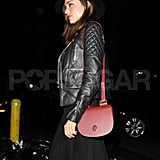 Miranda Kerr toted a red bag to dinner in NYC.