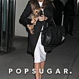 Miranda Kerr was on-trend in a black and white ensemble while out in NYC. She started with a white knee-length dress, then added a black coat, her favorite Givenchy bag, and black pointy pumps.