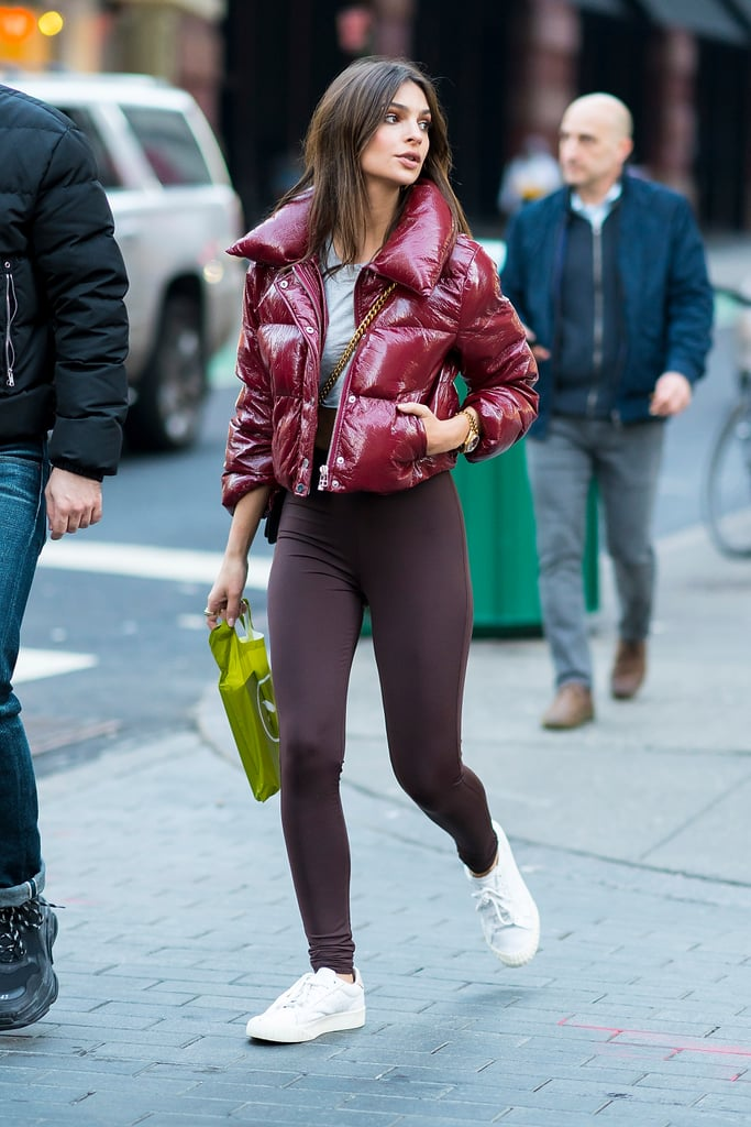 "The old debate ""Are leggings pants?"" has been settled by the rise of athleisure, and the answer is a resounding yes. Leave it to Emily Ratajkowki, however, to make wearing leggings look extra sexy. While most women might feel more comfortable covering up their behinds in these bottoms, Emily did the complete opposite. She rocked her high-waisted maroon pants with a cropped red jacket from LPA and an equally short gray t-shirt. She finished off with white sneakers and a crossbody bag. The star seemed confident and comfortable in her look, based on an Instagram video she took. The clip was shot from behind, zooming in on her booty in these Myra Swim leggings, before panning upwards to her back and face. If Emily, who has her own line of swimsuits, suddenly decides to launch a leggings collection too, we wouldn't object to making a few purchases. Read on to see her casual ensemble, then shop similar pieces to build up your athleisure collection.      Related:                                                                                                           Emily Ratajkowski's Sexiest Dress of All Time Had Her Just Shy of Naked"