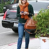Reese showed off her Fall layering skills with jeans and ankle boots in 2011.