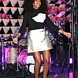 While performing at The Armory Party in NYC, Solange Knowles took her colour palette in a mod direction via a metallic miniskirt, black turtleneck with an abstract print, and black-and-white peep-toe booties.