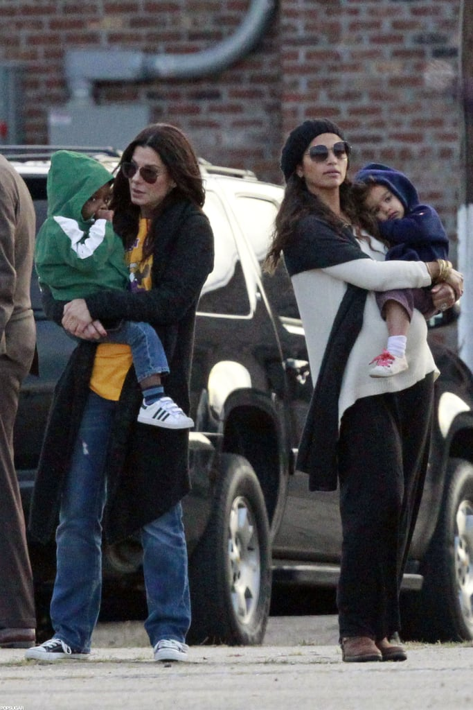Sandra Bullock watched after Louis Bullock as Vida McConaughey rested her head on mom Camila Alves.