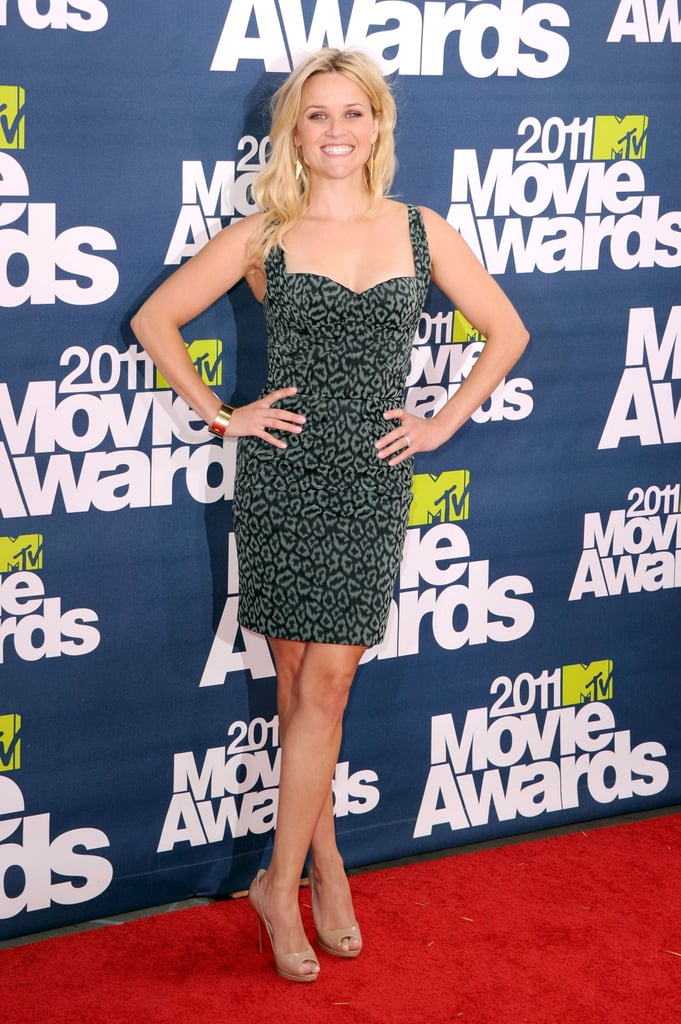 Reese Witherspoon rocked Zac Posen and smiled on her way into this evening's MTV Movie Awards, where she'll soon accept their Generation Award for her contributions to the movie industry with hits like Water For Elephants. Reese has been wearing a protective boot on her left foot for the past month while recovering from an ankle injury, but she switched into a sexy pair of nude pumps for today's special occasion! It will be a mini reunion for Reese and her Water For Elephants costar Robert Pattinson, who's on hand to debut the Breaking Dawn trailer with his Twilight buds Kristen Stewart, Taylor Lautner, and newly engaged Nikki Reed. Don't forget to check out FabSugar and BellaSugar's love it or leave it polls to weigh in on the night's fashion and beauty hits and misses!