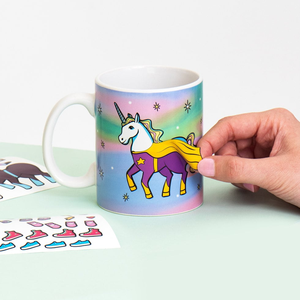 On a scale from one to insanely magical, this unicorn mug is pretty much off the charts. As if a unicorn-adorned mug isn't cute enough on its own, the Unicorn Dress-Up Mug ($14) from Firebox also comes with — wait for it — fashion and accessory stickers so that you can change the unicorn's outfits. It's basically a mug and a paper doll all in one, a combination I never knew I needed. Looking straight out of your childhood, the 40 stickers included with the mug are reusable, so your unicorn can rock a tutu, a cape, or some roller skates depending on your mood. A unicorn likes to look its best for every occasion, you know?      Related:                                                                                                           This GIANT Unicorn Pool Float Can Fit the Whole Family — Plus 1 or 2 More!