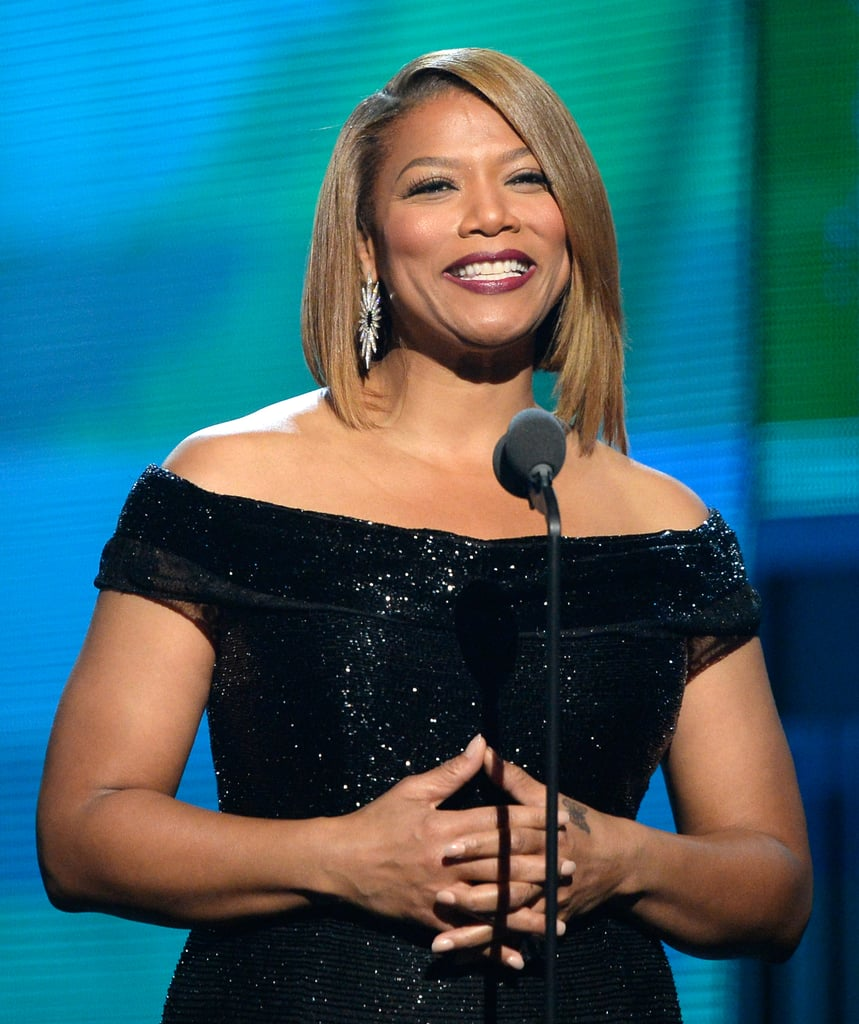 Queen Latifah introduced Macklemore & Ryan Lewis then served as a justice of the peace to marry 30 couples.
