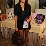 In 2009, she opted for a black romper, which she paired with sandals and a Louis Vuitton bag.