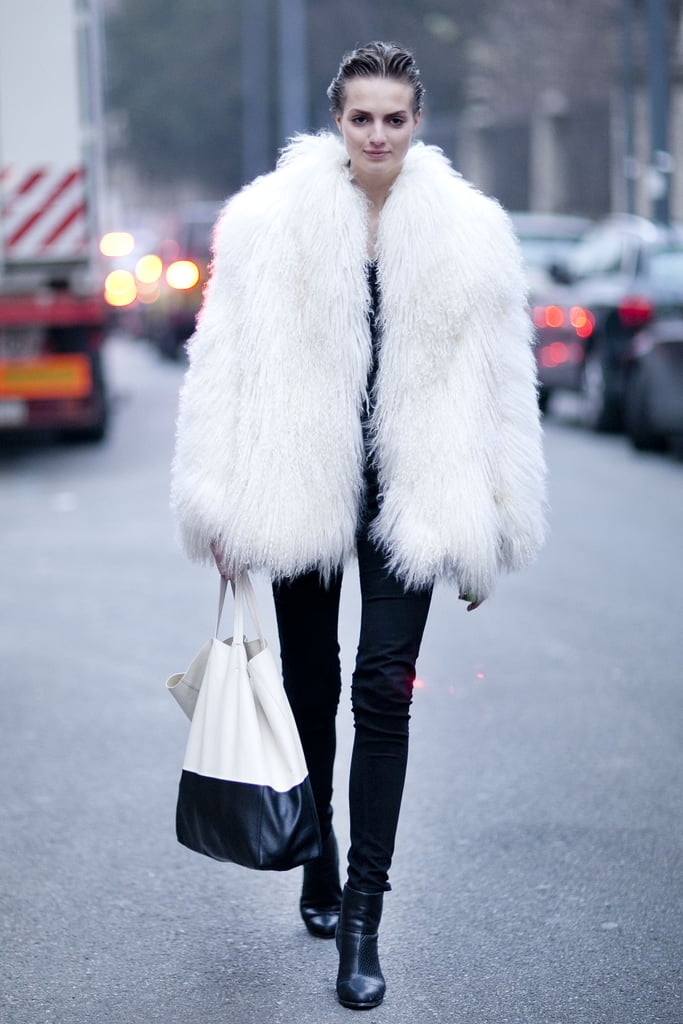 A white furry coat balanced out skinny bottoms and a minimalist tote.