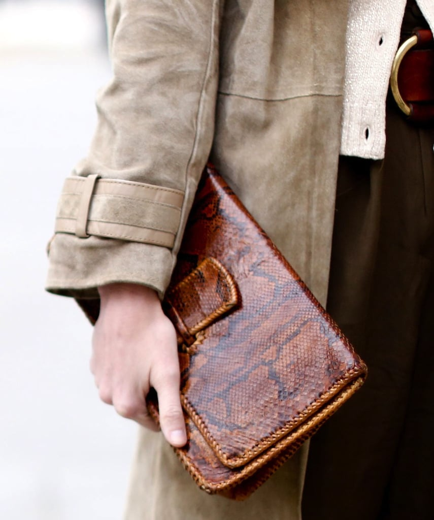 We love the vintage nature of this brown snakeskin printed clutch.
