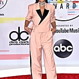 The actress hit the red carpet in this cool-girl suit by Pyer Moss. She completed the look with Louboutins and jewels by Jacob & Co., Djula, and Mattia Cielo.