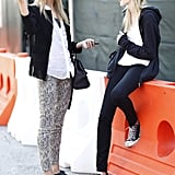 So much to love here — printed pants, brogues, fringe, Converse — a style twosome on the streets of NYFW. Source: Greg Kessler