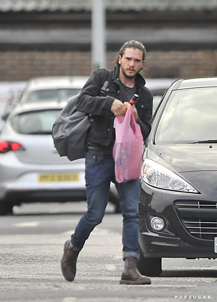As Game of Thrones fans continue to speculate on whether Jon Snow is alive or not, actor Kit Harington has been spending time in Belfast, Northern Ireland, where the show is filmed. Last week, he and his still-long hair were spotted making a shopping trip, looking casual in jeans and a jacket as he picked up some pizza and wine. The sighting comes after he stepped out with a Game of Thrones costar last month, all smiles as he and Ben Crompton strolled through Belfast. He might have been spending time in Northern Ireland for a reason totally unrelated to the series, or, as we said before, he may just be needed to shoot a few scenes — a funeral scene, perhaps? In any case, for those still holding out hope for Jon Snow, this may be a good sign. Keep reading for pictures of Kit Harington's Belfast outing, then check out nine things we know about Game of Thrones season six plus an ode to Jon Snow.
