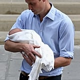 It was love at first sight for William holding newborn George in 2013.