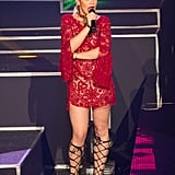 While performing at Etam's lingerie show during PFW, Rita Ora showed off her gorgeous gams in a red lace Emilio Pucci mini and leather gladiator sandals.