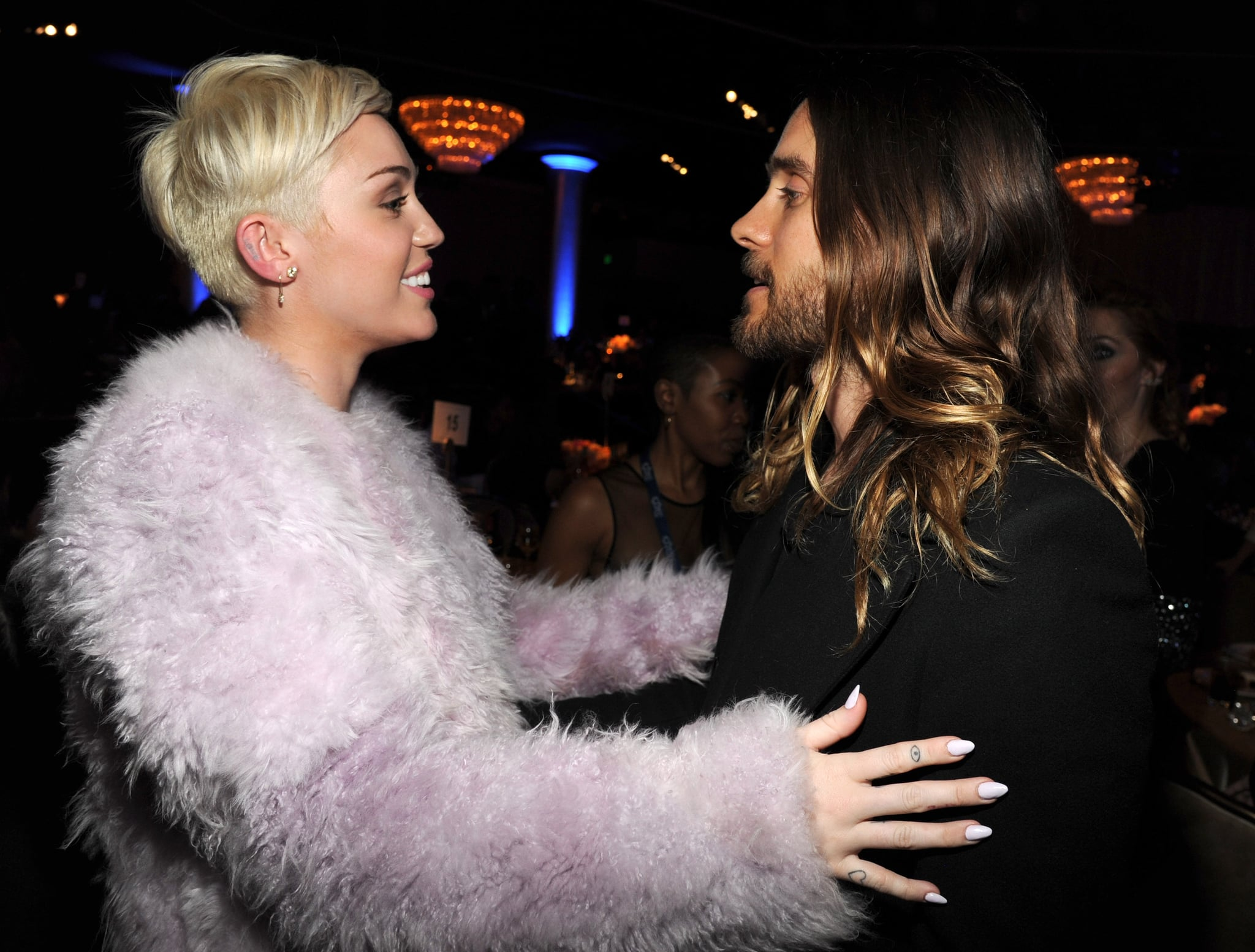 Miley Cyrus beamed while chatting with Jared Leto.