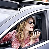 Laura Dern as Renata Klein in a multicolor stitched sweater and Garrett Leight sunglasses.