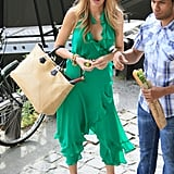 While filming a scene for Gossip Girl in Paris, Blake donned a ruffly green jumpsuit with a glamorous wide-brim floppy hat. To get her chic look, try this Forever 21 patterned floppy hat ($13) with a colorful outfit.