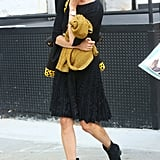 This ladylike mix got a downtown vibe via tougher ankle boots. Source: Greg Kessler