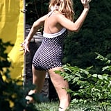 Blake Lively threw a ball at the dunk tank while celebrating the Fourth of July with Ryan Reynolds in New York.