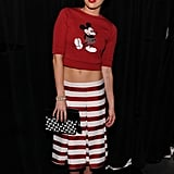 Miley Cyrus also showed off her midriff in a cropped Mickey Mouse sweater and a striped skirt at the Marc Jacobs show.