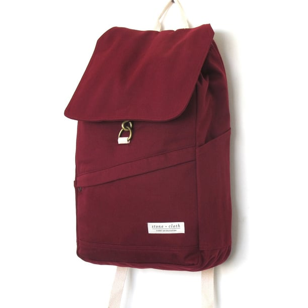 We love the deep hue of this sleek Stone and Cloth Benson backpack ($74) in cranberry.