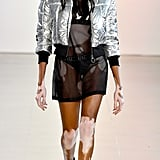 She looked hot, hot, hot in a see through minidress covered by a metallic bomber jacket.