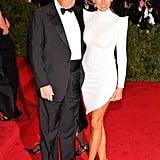 In May 2012, Melania attended the Schiaparelli and Prada themed Met Gala in a Marc Bouwer Couture minidress with spiked shoulders and Christian Louboutin glitter heels.